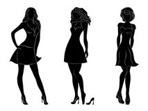 Three beautiful slim women silhouettes. Three beautiful slim women black silhouettes with white contours, hand drawing vector artwork Stock Illustration