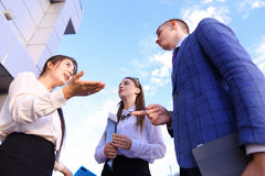 Three beautiful smart young businessman talking, shaking hands, Stock Image
