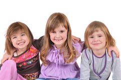 Three beautiful smiling girl in white background. Happy stock photography