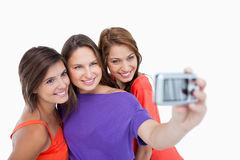 Three beautiful teenage girls standing Stock Images