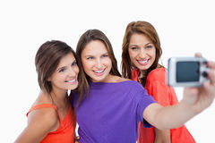 Three beautiful teenagers showing beaming smile Stock Photos