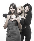 Three beautiful woman friends posing. Three beautiful women friends posing over white background Stock Photography