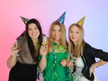 Three beautiful woman with glasses of champagne Royalty Free Stock Image