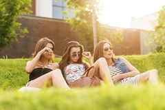 Three Beautiful woman looking at the handsome men in the grass Stock Photos