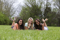 Three beautiful woman in the park Royalty Free Stock Photo