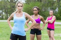 Three beautiful woman prepare to run Royalty Free Stock Image