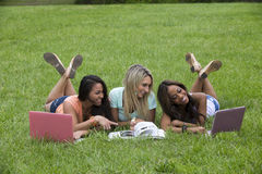 Three beautiful woman study in the park Royalty Free Stock Photos