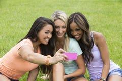 Three beautiful woman take a photo Royalty Free Stock Images