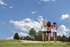 Three beautiful woman walk in the park Royalty Free Stock Photography
