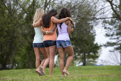 Three beautiful woman walk in the park Royalty Free Stock Image