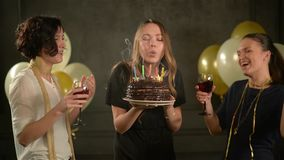 Three Beautiful Women Celebrate and Applaud, One of Them Holding Chocolate Cake, Another Two Clinking Glasses with Wine. Three Beautiful Women Celebrate and stock video