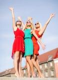 Three beautiful women in the city Stock Image