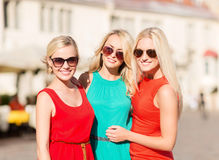 Three beautiful women in the city Stock Photo