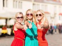 Three beautiful women in the city Royalty Free Stock Photos