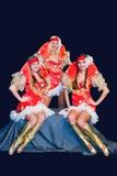 Three  beautiful women in dresses Stock Image