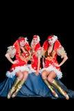 Three  beautiful women in dresses Stock Photos
