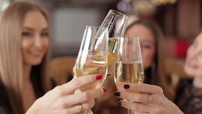Three beautiful women with glasses of champagne celebrating on party. stock video footage
