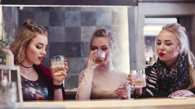 Three beautiful women having a drink in a glamorous bar. Having fun, little female party. Hen night. Amazing outfit. stock video footage