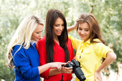 Three beautiful women having a photosession in the park Stock Photo
