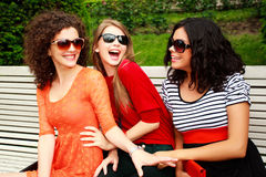 Three beautiful women laughing and having fun stock photos