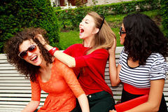 Three beautiful women laughing and having fun Stock Images