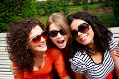 Three beautiful women laughing and having fun. Outdoors on a sunny day stock photos