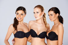 Three beautiful women modeling black lingerie Stock Photography