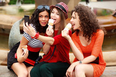 Three beautiful women photographing themselves Royalty Free Stock Photos