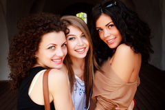 Three beautiful women smiling outdoor Royalty Free Stock Images