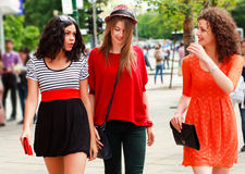 Three beautiful women smiling on the street Royalty Free Stock Photos