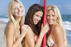 Three Beautiful Women Surfers With Surfboard Royalty Free Stock Image