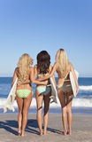 Three Beautiful Women Surfers With Surfboards Royalty Free Stock Photography