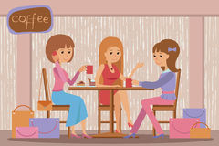 Three beautiful women talking at coffee shop while drinking hot coffee Stock Images