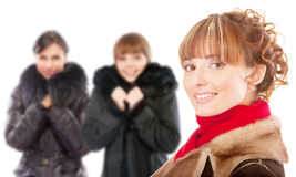 Three beautiful women in winter coats Stock Photography