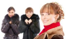 Three beautiful women in winter coats Stock Photography