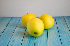 Three beautiful yellow apples stock photo