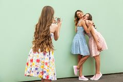 Three beautiful young adult girl taking photo with a smart phone. Royalty Free Stock Photography