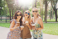 Three beautiful young boho chic stylish girls walking in park. Royalty Free Stock Photos