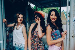 Three beautiful young girls at the bus stop Royalty Free Stock Image