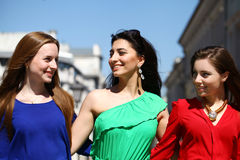 Three Beautiful young women in colorful dress Stock Images
