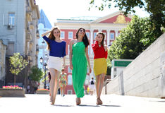 Three Beautiful young women in colorful dress Royalty Free Stock Photos