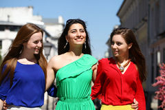 Three Beautiful young women in colorful dress Royalty Free Stock Image