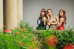 Three beautiful young women in evening dresses Stock Photography