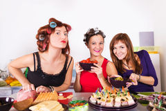 Three beautiful young women housewifes cook together Stock Photography