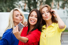 Three beautiful young women posing and grimacing stock photography