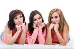 Three beautiful young women posing Stock Photography