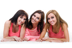 Three beautiful young women posing Royalty Free Stock Photos