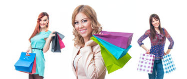 Three beautiful young women with shopping bags Stock Photos
