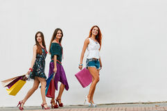 Three beauty sisters with Shopping Bags Royalty Free Stock Photography
