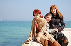 Three beautyful girls at coast Royalty Free Stock Photography